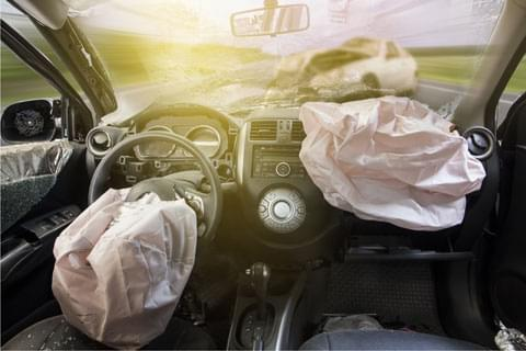 Inside of a car with deployed airbags